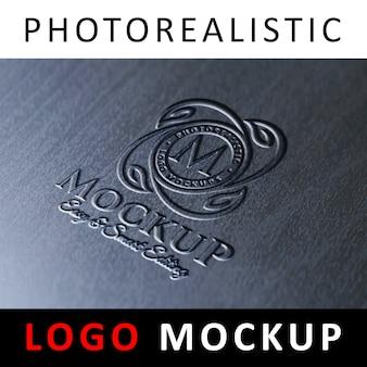 Logo mock up - logotipo en relieve moldeado en superficie metálica