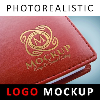 Logo mockup - logo met gouden inscriptie op rode boekomslag