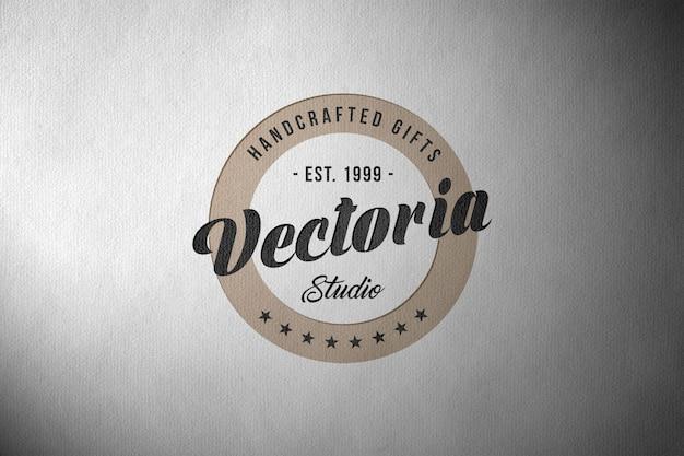 Logo mockup op papier textuur