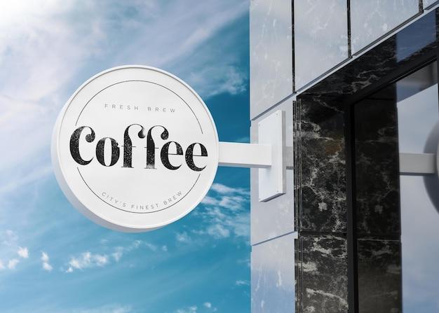 Logo mockup ronde witte bord gevel op zwart marmeren gebouw