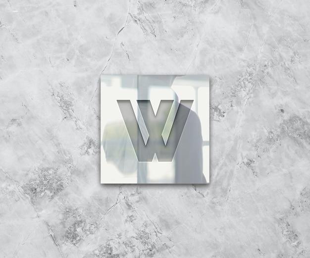 Logo op glas en marmeren textuur vooraanzicht mockup