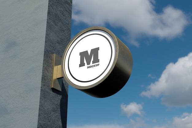 Logo teken mockup moderne ronde ronde bewegwijzering aan de buitenkant met blauwe lucht