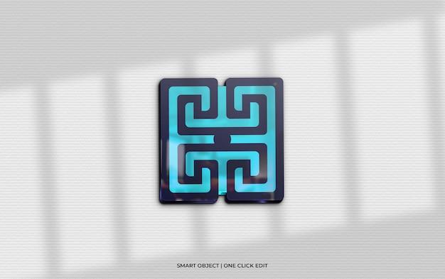 Logomodel met 3d-glasreflectie en schaduw op de muur