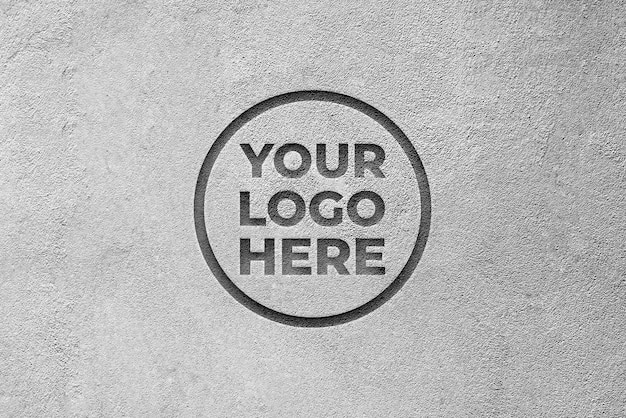 Logomodel met graveereffect op cementachtergrondtextuur