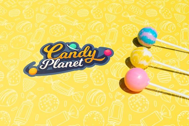 Logotipo de candy planet con planetas de azúcar de piruleta