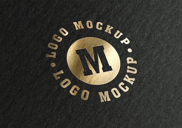 Logotipo dorado de papel negro de lujo