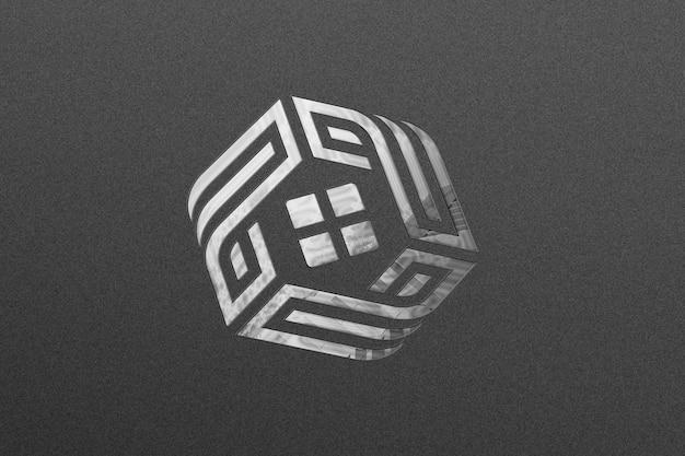 Logotipo de maqueta plateada en textura de papel negro