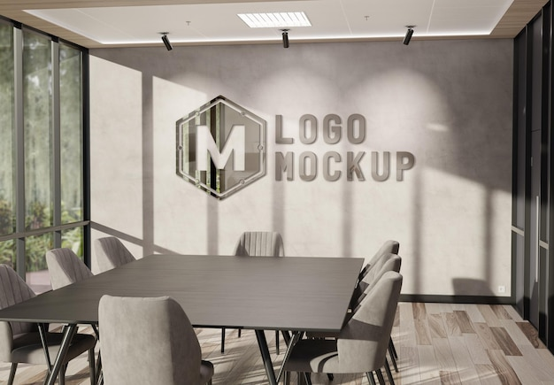 Logotipo en la pared de la oficina con maqueta de efecto metálico 3d