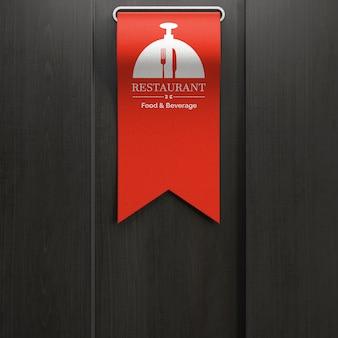 Logotipo del restaurante en la cinta.