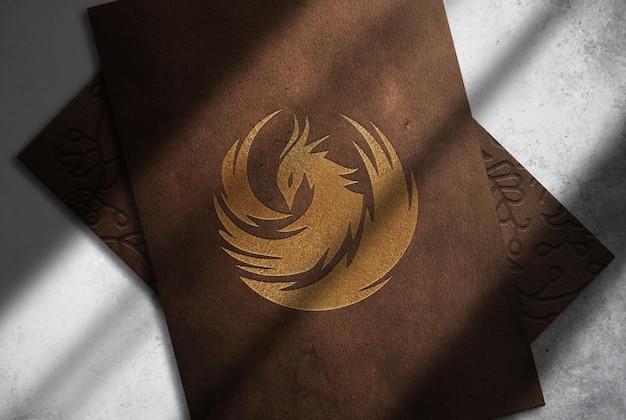 Luxe lederen phoenix papier reliëf bovenaanzicht mockup