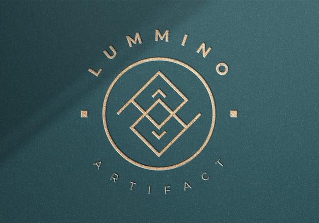 Luxe logo mockup op gestructureerde achtergrond van bovenaanzicht
