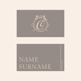 Luxe visitekaartjesjabloon psd in goud- en grijstint met platliggend voor- en achteraanzicht