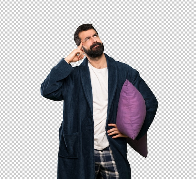 Man met baard in pyjama twijfels en denken