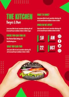 Mani che tengono gustoso hamburger americano
