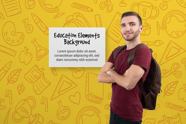 Mannelijke student met gekruiste armen