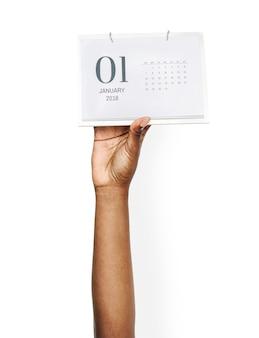 Mano che tiene il calendario
