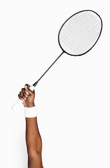 Mano che tiene il club di tennis