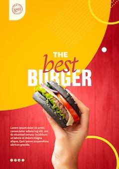 Mano che tiene il modello di hamburger panino nero