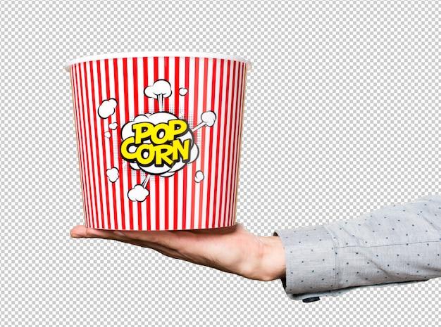 Mano dell'uomo che tiene la scatola di popcorn