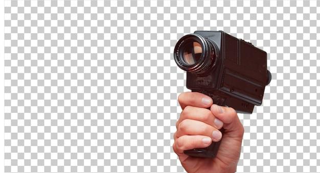 Mano masculina aislada sosteniendo una cámara super 8 vintage