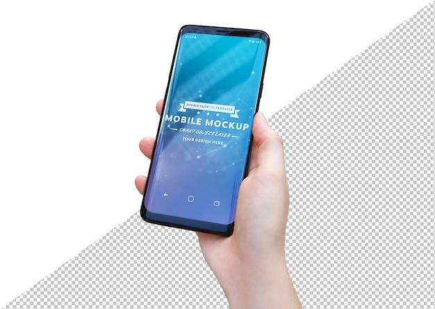 Mano de mujer con maqueta de smartphone moderno