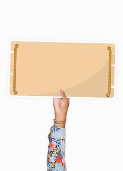 Mano sosteniendo un cartel de cartulina en blanco