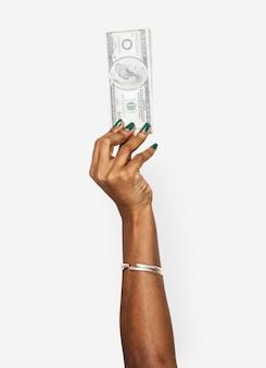 Mano sosteniendo nota de dólar