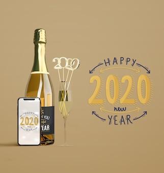 Maqueta de año nuevo con champaña