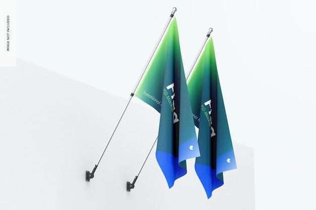 Maqueta de banderas en pared blanca