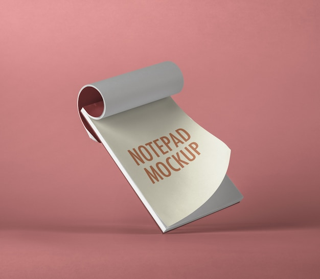 Maqueta de bloc de notas voladora