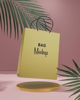 Maqueta de bolsa de compras dorada sobre fondo rosa con palmeras tropicales render 3d