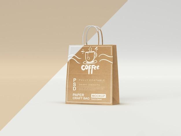 Maqueta de bolsa de papel artesanal totalmente editable con logotipo y texto en blanco imagen de compras estampadas