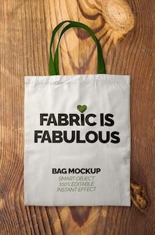 Maqueta de bolsa de tela con asas verdes