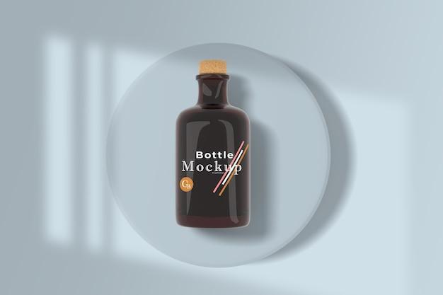 Maqueta de botella de aceite de vidrio minimalista con superposición de sombras