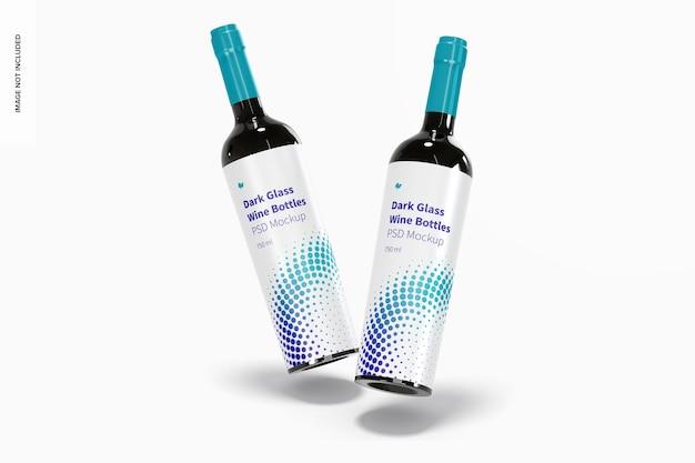 Maqueta de botellas de vino de vidrio oscuro, cayendo