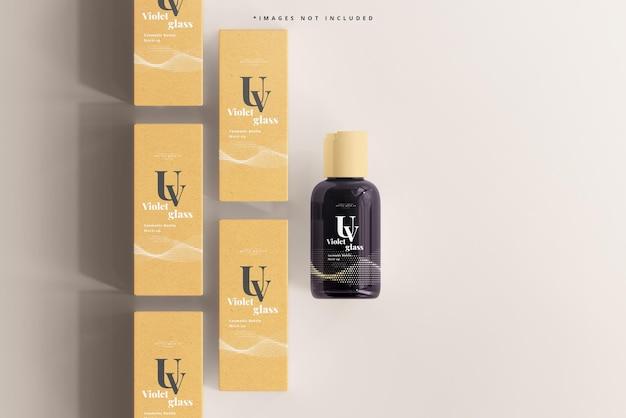 Maqueta de caja y botella cosmética de vidrio uv