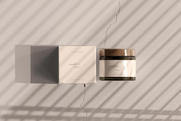 Maqueta de caja y tarro cosmético de vidrio ámbar