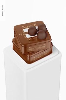 Maqueta de cajas de lata de chocolate cuadradas, apiladas