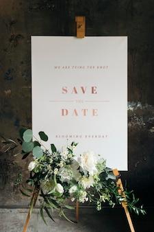 Maqueta de cartel de boda con hermosas flores blancas