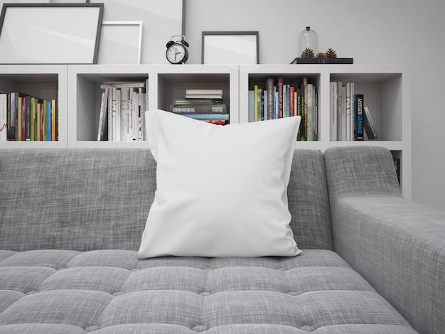 Maqueta de cojín blanco en blanco en un sofá