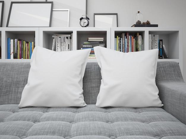 Maqueta de cojines en blanco blanco en un sofá
