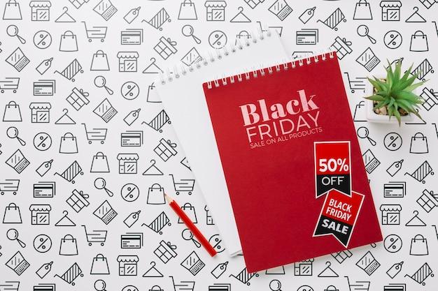 Maqueta de concepto de viernes negro con cuaderno