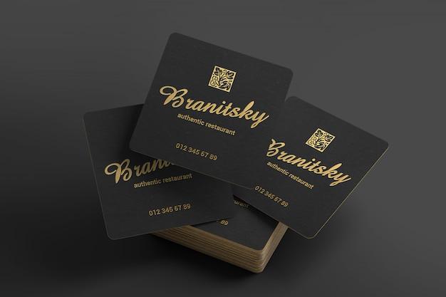 Maqueta creativa de tarjetas de visita cuadradas en negro y dorado