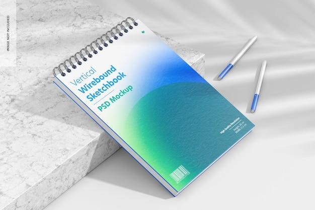 Maqueta de cuaderno de bocetos encuadernado verticalmente, perspectiva
