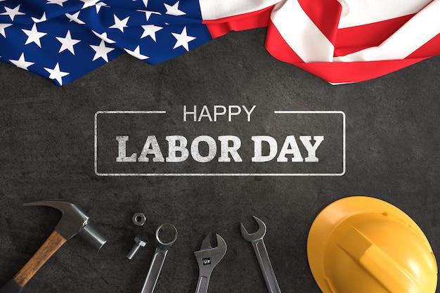 Maqueta del día del trabajo con herramientas de mano y bandera estadounidense