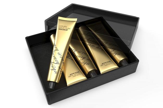 Maqueta de diseño de empaque 3d de cinco tubos de oro de lujo en caja negra abierta