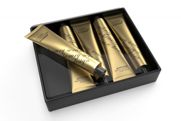 Maqueta de diseño de empaque 3d de cinco tubos de oro de lujo en caja negra