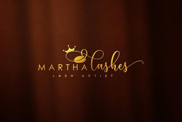 Maqueta dorada del logotipo 3d en cuero marrón