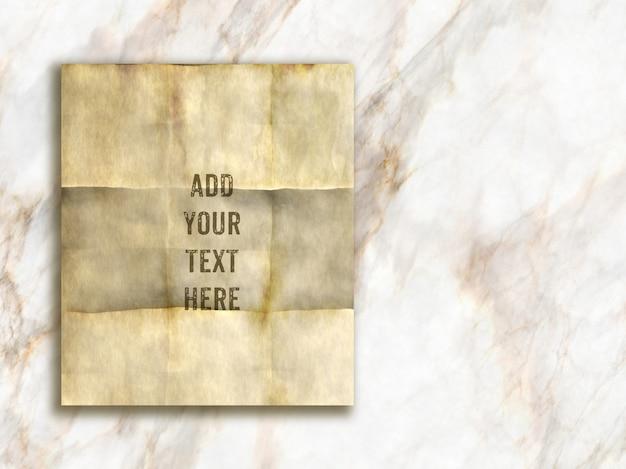 Maqueta editable con papel de estilo grunge sobre una textura de mármol