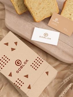 Maqueta de empaque de pan con tarjeta de visita
